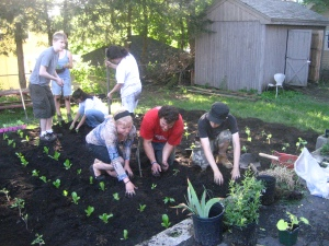 Gardeners working on starting a garden at the Dismas House in Worcester