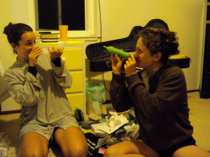Toni and Sarah play around with cups during their summer 2011 bike trip down the West Coast.
