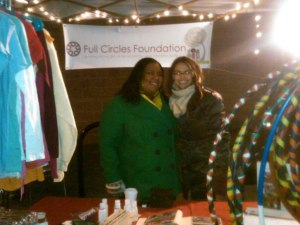 FCF Program Leader Elyse Harris and Resource Generation Coordinator Marcie Hawkins Smith volunteer at March's First Friday!