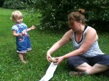 Bonnie and Lyric making newspaper pots