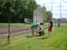 Interns building the Youth Farm fence