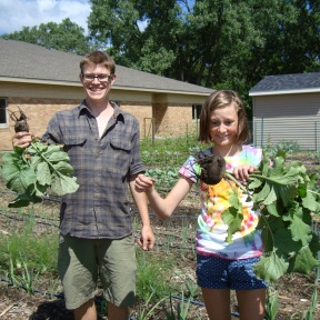 Colin and Hadley with huge radishes!